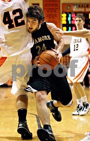 Rob Winner – rwinner@daily-chronicle.com<br /> Sycamore's Harlan Johnson (24) is called for charging after driving to the basket during the fourth quarter and colliding with DeKalb's Jordan Threloff. DeKalb went on to defeat Sycamore, 53-43, on Saturday February 20, 2010 in DeKalb, Ill.