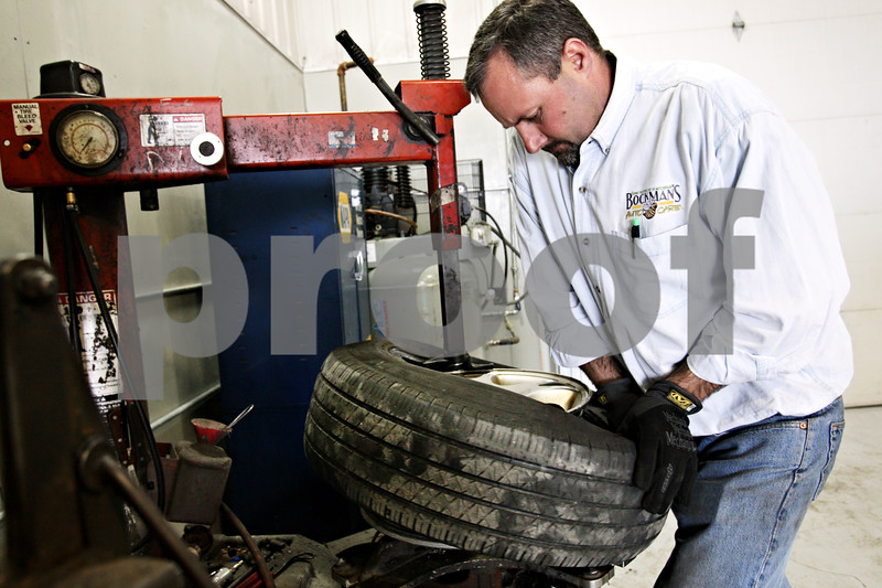 Beck Diefenbach  -  bdiefenbach@daily-chronicle.com<br /> <br /> Shop owner Jon Bockman installs a tire onto a wheel on his company's first day at its new location at 2158 Oakland Dr. in Sycamore on Monday March 29, 2010.