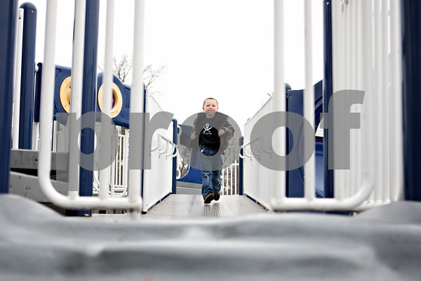 Rob Winner – rwinner@daily-chronicle.com<br /> <br /> Zach Urich, 5 of Malta, runs across a bridge on the playground at Hopkins Park in DeKalb, Ill. on Wednesday March 24, 2010.