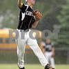 Beck Diefenbach  -  bdiefenbach@daily-chronicle.com<br /> <br /> Kaneland's Jake Fiedler (27) hurls the ball to first base for the out during the third inning of the game against DeKalb at DeKalb High School in Dekalb, Ill., on Thursday May 20, 2010.