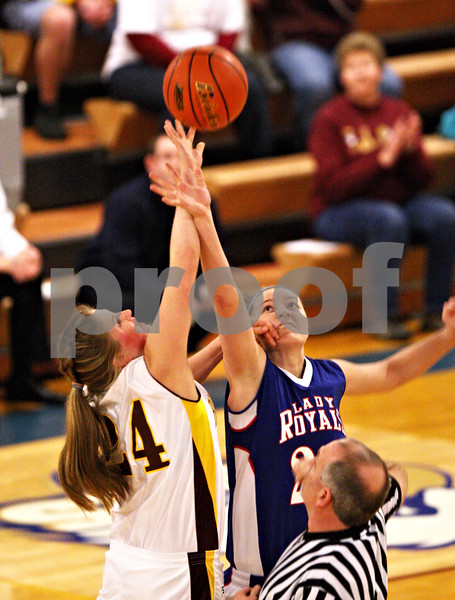 Beck Diefenbach  -  bdiefenbach@daily-chronicle.com<br /> <br /> Hinckley-Big Rock's Jenna Thorp (right) leaps for the jump ball against Stockton's  Haley Magee at the start of the IHSA Class 1A Super Sectional championship game at Judson University in Elgin, Ill., on Monday Feb. 22, 2010.