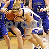 Beck Diefenbach  -  bdiefenbach@daily-chronicle.com<br /> <br /> Hinckley-Big Rock's Maxine Rossler (22)  battles Newark's Katie Larson (12) for the ball during the second quarter of the game at H-BR High School in Hinckley, Ill., on Thursday Jan. 14, 2010. H-BR defeated Newark 46 to 30.