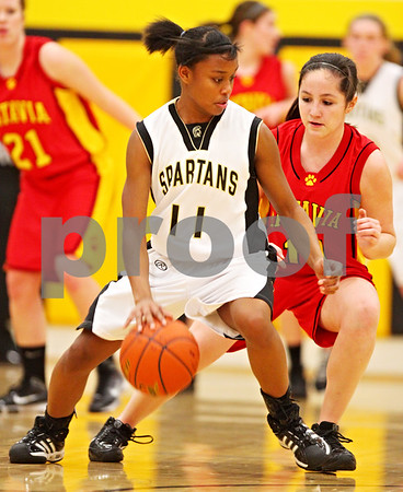 Beck Diefenbach  -  bdiefenbach@daily-chronicle.com<br /> <br /> Sycamore's Lake Kwaza (11, left) dribbles the ball around Batavia's Sami Villareal (11) during the first quarter of the game at Sycamore High School in Sycamore, Ill on Tuesday Jan. 5, 2009. Sycamore defeated Batavia 35 to 25.