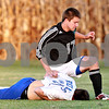 Beck Diefenbach – bdiefenbach@daily-chronicle.com<br /> <br /> Hinckley-Big Rock's Time Engle (21, bottom) and Earlville-Leland's Tom Johnson (17) collide during the second half of the Little 10 Conference tournament game at H-BR High School in Hinckley, Ill., on Wednesday Oct. 6, 2010. The collision spurred a fight between other members of the team which resulted in two red cards.