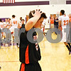 Beck Diefenbach - bdiefenbach@daily-chronicle.com<br /> <br /> DeKalb's Brian Sisler (22, center) reacts after the Barbs lose to Oswego in the sectional championship game at Hampshire High School in Hampshire, Ill., on Friday March 12, 2010. Oswego defeated DeKalb 57 to 51, ending the Barb's season.