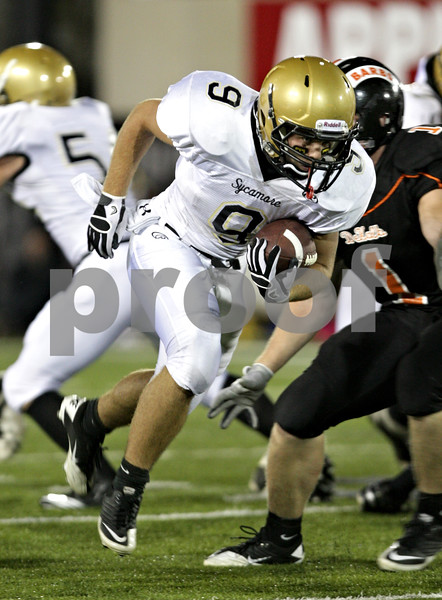 Beck Diefenbach – bdiefenbach@daily-chronicle.com<br /> <br /> Sycamore's Tommy Nice (9) rushes with the ball during the second quarter of the Castle Challenge football game between DeKalb and Sycamore High Schools at Huskie Stadium on the campus of Northern Illinois University in DeKalb, Ill., on Friday Sept. 10 2010.