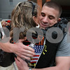 Rob Winner – rwinner@daily-chronicle.com<br /> <br /> USMC Corporal Klye LeJeune (right), of Sandwich, is hugged by Terry VanGundy, of St. Charles, while receiving a hero's welcome by the Warriors'  Watch Riders at the Timber Creek Inn and Suites in Sandwich, Ill. on Saturday April 24, 2010.