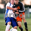Beck Diefenbach – bdiefenbach@daily-chronicle.com<br /> <br /> Hinckley-Big Rock's Zach Michels (44, left) and DeKalb's Kyle Berg (15) collide during the first half of the game at H-BR High school in Hinckley, Ill., on Monday Sept. 13, 2010. DeKalb defeated H-BR 1 to 0.