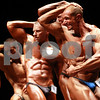 Kyle Bursaw – kbursaw@daily-chronicle.com<br /> <br /> Bodybuilders Jim Kitchen, center, and Aaron Lobliner, right, show off various different muscle groups as they are judged at the Egyptian in DeKalb, Ill. on Saturday, Nov. 20, 2010.