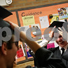 Beck Diefenbach  -  bdiefenbach@daily-chronicle.com<br /> <br /> Dylan Boyer (right) shares a laugh with classmates before the graduation ceremony at Sandwich High School in Sandwich, Ill., on Sunday May 23, 2010.
