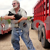 "Beck Diefenbach  -  bdiefenbach@daily-chronicle.com<br /> <br /> Chauncy Watson picks up his new puppy, Cinders, while working on his farm on Saturday August 21, 2010. Cinders was resting under the trailer when Watson picked the puppy up. ""You're too valuable to me, my little friend,"" he said."