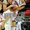 Beck Diefenbach  -  bdiefenbach@daily-chronicle.com<br /> <br /> Northern Illinois' Lee Fisher (30, right) and Western Michigan's David Kool (23) fight for the ball during the first half of the game at the Convocation Center at NIU in DeKalb, Ill., on Wednesday Jan. 13, 2010.