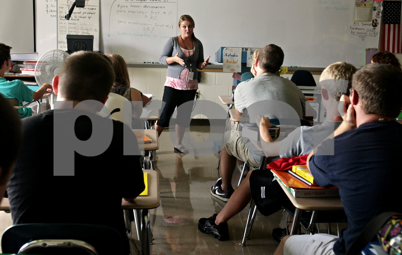 Beck Diefenbach  -  bdiefenbach@daily-chronicle.com<br /> <br /> A DeKalb high school graduate herself, Northern Illinois University student Randi Goff introduces herself to a spanish class which she will be co-teaching at DeKalb High School in DeKalb, Ill., on Tuesday Aug. 31, 2010.