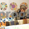 Rob Winner – rwinner@daily-chronicle.com<br /> <br /> Dorothy Rehn, of Belvidere, examines one of the quilts on display at the Kirkland Historical Society Quilt Show at United Methodist Church in Kirkland, Ill. on Saturday March 20, 2010.