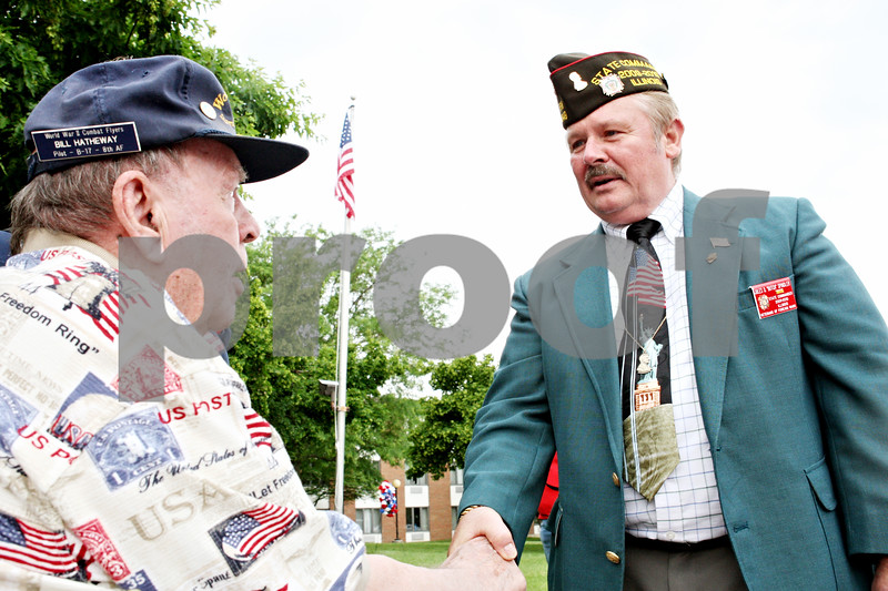 """Rob Winner – rwinner@daily-chronicle.com<br /> <br /> Jules D. """"Butch"""" Spindler, the Illinois VFW State Commander, presents Oak Crest resident and World War II veteran Bill Hatheway with a pin after a Memorial Day ceremony on Monday May 31, 2010 in DeKalb, Ill."""