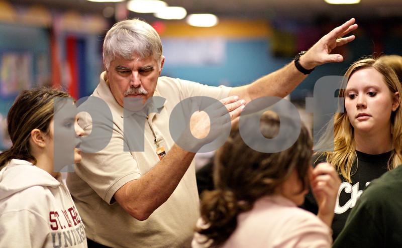 Beck Diefenbach  -  bdiefenbach@daily-chronicle.com<br /> <br /> DeKalb bowling head coach Bill Holland talks strategy with freshman Kodi Underwood (far left) during practice at Mardi Gras Lanes in DeKalb, Ill., on Tuesday Feb. 9, 2010.