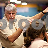 Beck Diefenbach  -  bdiefenbach@daily-chronicle.com<br /> <br /> DeKalb bowling head coach Bill Holland talks strategy with freshman Kodi Underwood (far left) during practice at Mardi Gras Lanes in DeKalb, Ill., on Tuesday Feb. 9, 2010.
