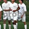 Rob Winner – rwinner@daily-chronicle.com<br /> <br /> Kaneland's Jordan Escobedo (10) celebrates his gaming winning goal in overtime with teammates Derek White (left) and Kris Leeseberg on Wednesday October 20, 2010 in Sycamore, Ill.