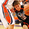 Beck Diefenbach - bdiefenbach@daily-chronicle.com<br /> <br /> DeKalb's Dylan Donnelly (12, right) tries to make a hole during the first quarter of the sectional championship game against Oswego at Hampshire High School in Hampshire, Ill., on Friday March 12, 2010. Oswego defeated DeKalb 57 to 51, ending the Barb's season.