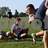 Beck Diefenbach  -  bdiefenbach@daily-chronicle.com<br /> <br /> Sycamore Rugby Football Club member Patrick Peck (right) tackles a teammate with the ball during practice at Sycamore High School in Sycamore, Ill., on Tuesday May 4, 2010.