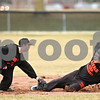 Beck Diefenbach  -  bdiefenbach@daily-chronicle.com<br /> <br /> DeKalb's Brian Sisler (left) tags out Frank Petras at second base during practice at DeKalb High School in DeKalb, Ill., on Monday March 15, 2010.