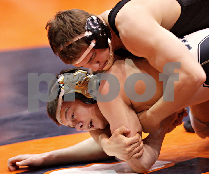 Beck Diefenbach - bdiefenbach@daily-chronicle.com<br /> <br /> Sycamore's Zack Spiewak (bottom) wrestles against Crystal Lake Central's Joey Kielbasa during the 152 weight class match of the IHSA Class 2A dual team state tournament at the U.S. Cellular Coliseum in Bloomington, Ill., on Saturday Feb. 27, 2010.