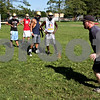 Rob Winner – rwinner@daily-chronicle.com<br /> <br /> Coach Sean Donnelly demonstrates a drill for his players during the Hawks' morning practice on Thursday August 12, 2010 in Kirkland, Ill.