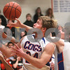 Kyle Bursaw – kbursaw@daily-chronicle.com<br /> <br /> Robert Thurlby and Andrew Oplt both grab for a rebound in the second quarter of their game against Harvard at Genoa-Kingston High School on Tuesday, Dec. 07, 2010.