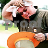Rob Winner – rwinner@daily-chronicle.com<br /> <br /> Bob Coyle, of Cortland, wipes himself off while working at Mound Rest Cemetery in Cortland, Ill. on Friday June 11, 2010. Coyle, who is the president of the association that manages the cemetery, says that it takes at least 15 - 20 hours a week of volunteer time just to maintain the cemetery.