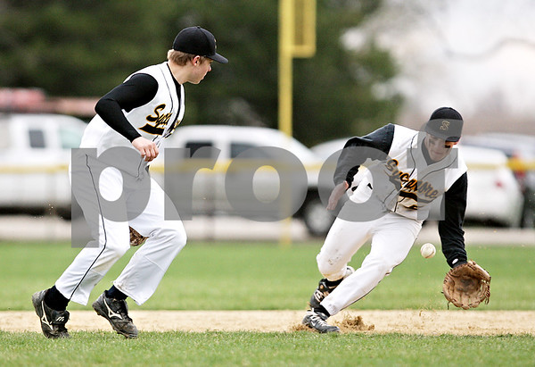 Beck Diefenbach  -  bdiefenbach@daily-chronicle.com<br /> <br /> Sycamore's Eric Ray (5, right) fields a ground ball during the fifth inning of the game against DeKalb at Sycamore Park in Sycamore, Ill., on Thursday April 8, 2010.