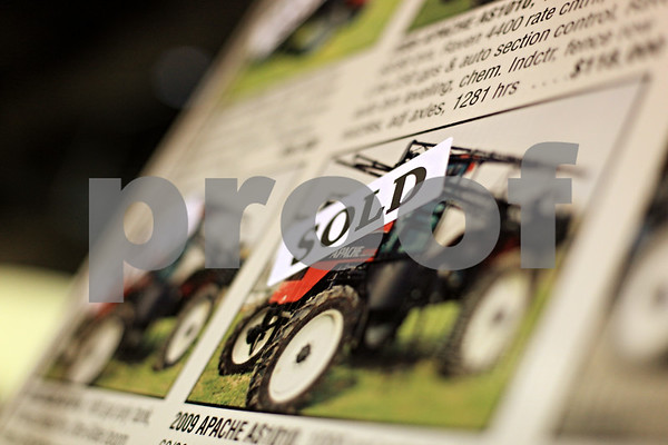 Beck Diefenbach  -  bdiefenbach@daily-chronicle.com<br /> <br /> A sold sign adorns an advertisement for a tractor at the Northern Illinois Farm Show at the Northern Illinois University Convocation Center in DeKalb, Ill., on Wednesday Jan. 6, 2009.