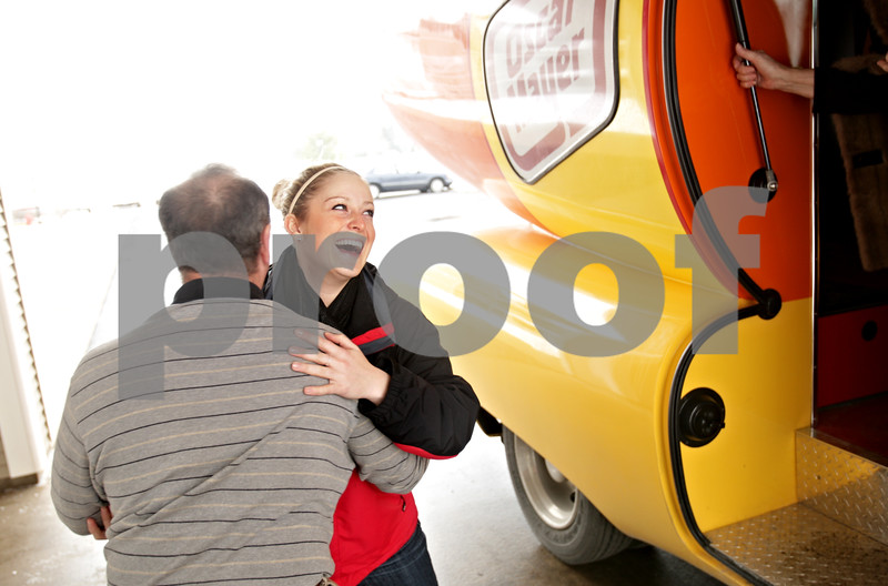 Beck Diefenbach  -  bdiefenbach@daily-chronicle.com<br /> <br /> Peter Montavon, center, of Sycamore, is helped down from the Oscar Meyer Wienermobile by the hot dog's driver Victoria Oleson outside the Grand Victorian in Sycamore, Ill., on Friday Jan. 15, 2010.