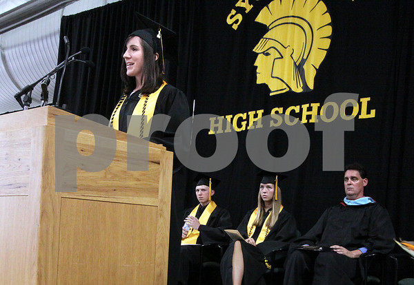 Wendy Kemp/For The Daily Chronicle<br /> Valedictorian Nicole O'Connor addresses the class during the graduation ceremony at Sycamore High School on Sunday.<br /> Sycamore 5/30/10