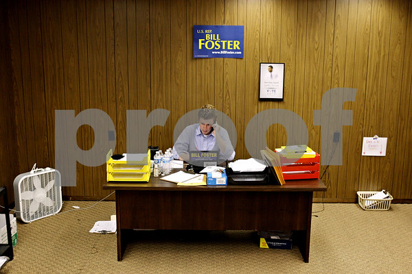 Rob Winner – rwinner@daily-chronicle.com<br /> <br /> Eric Pond, a field organizer of DeKalb county, makes a telephone call at Bill Foster's campaign office in downtown DeKalb, Ill. on Thursday October 7, 2010.