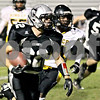 Wendy Kemp - For The Kane County Chronicle<br /> Kaneland's Quinn Buschbacher carries the ball during Friday's playoff game against King College Prep.<br /> Maple Park 10/29/10