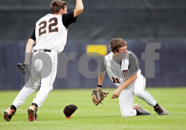 Rob Winner – rwinner@daily-chronicle.com<br /> <br /> Brian Sisler (22) reacts as Cody Varga makes a catch in left field and throws to first for an attempt at a double play in the  third inning during the IHSA Class 3A Augustana College Super-Sectional on Monday June 7, 2010. DeKalb defeated Galesburg, 8-4.