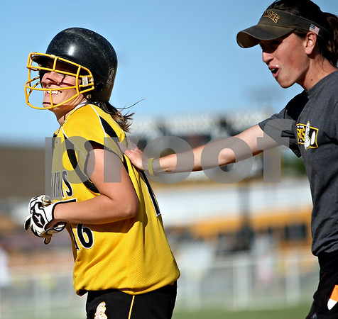 Beck Diefenbach  -  bdiefenbach@daily-chronicle.com<br /> <br /> Sycamore's Nicole Schroeder (16, left) shares a laugh head coach Jill Carpenter during the third inning of the IHSA Class 2A Regional semi final game against DeKalb at Sycamore High School in Sycamore, Ill., on May 27, 2010.