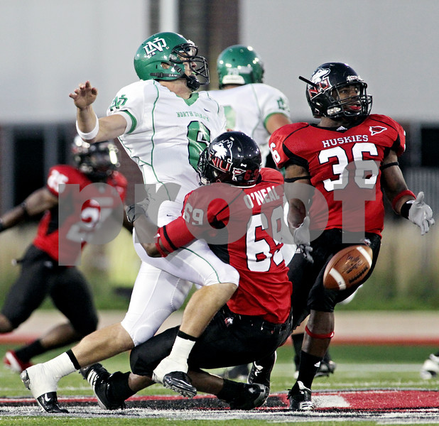 Rob Winner – rwinner@daily-chronicle.com<br /> <br /> North Dakota quarterback Jake Landry is hit by Northern Illinois defensive end Stephen O'Neal during the second quarter in DeKalb, Ill. on Saturday September 11, 2010. Northern Illinois went on to defeat North Dakota, 23-17.