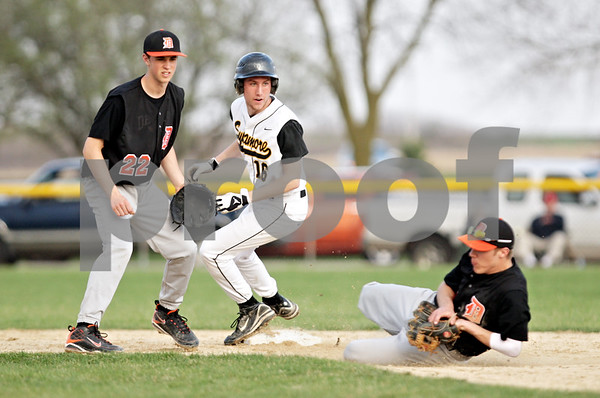 Beck Diefenbach  -  bdiefenbach@daily-chronicle.com<br /> <br /> DeKalb's Brian Sisler (22, left) and Sycamore's John Copple (16, center) watch as DeKalb's Kevin Sullivan (6, right) slides to catch a pop fly during the bottom of the sixth inning of the game at Sycamore Park in Sycamore, Ill., on Tuesday April 6, 2010.