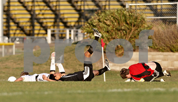 Rob Winner – rwinner@daily-chronicle.com<br /> <br /> Kaneland's Trevor Wolf (from left to right), Matthew Maillefer, and Kaneland goalkeeper J.P. Minogue collide on a scoring chance by Sycamore during the second half of their IHSA Class 2A Sycamore Regional semifinal on Wednesday October 20, 2010 in Sycamore, Ill. Kaneland went on to defeat Sycamore, 2-1.