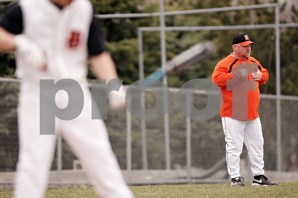 Beck Diefenbach  -  bdiefenbach@daily-chronicle.com<br /> <br /> DeKalb DeKalb head coach Justin Keck signals to his runner on first base during the bottom of the sixth inning of the game against Sandwich at DeKalb High School in DeKalb, Ill., on Wednesday March 24, 2010. DeKalb defeated Sandwich 7 to 1.