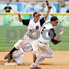 Beck Diefenbach  -  bdiefenbach@daily-chronicle.com<br /> <br /> DeKalb's Kevin Sullivan (6, right) reacts after Trenton Sopko (9) makes the out at second base to defeat Marian Central in IHSA Class 3A State Semifinal Game in Joliet, Ill., on Friday June 11, 2010.