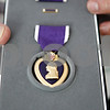 Rob Winner – rwinner@daily-chronicle.com<br /> <br /> Ernest Pinne, of Genoa, holds a Purple Heart which was awarded to his brother, Henry Pinne, who died while serving in World War II in 1945.<br /> <br /> Genoa, Ill.<br /> Thursday May 27, 2010