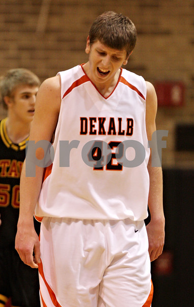 Beck Diefenbach  -  bdiefenbach@daily-chronicle.com<br /> <br /> DeKalb's Jordan Threloff (42, left) reacts after being called for offensive goaltending during the second quarter of the game against Batavia at DeKalb High School in DeKalb, Ill., on Tuesday Jan. 26, 2010.