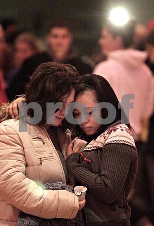 "Kyle Bursaw - kbursaw@daily-chronicle.com<br /> <br /> Laura Barbaro and Martha Tellez embrace after the community gathering honoring Antinette ""Toni"" Keller on Tuesday. 10.26.10"