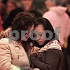 "Kyle Bursaw - kbursaw@daily-chronicle.com<br /> <br /> Laura Barbaro and Martha Tellez embrace after the community gathering honoring Antinette ""Toni"" Keller on Tuesday. 10.26.10"