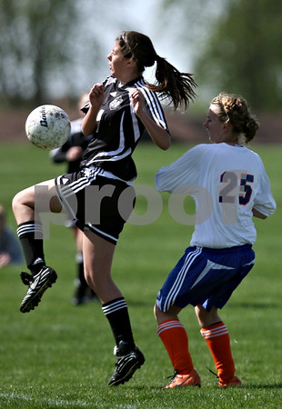 Rob Winner – rwinner@daily-chronicle.com<br /> <br /> Indian Creek's Leigh Cregier goes up for a ball during the first half of their game against Genoa-Kingston on Saturday April 17, 2010 in DeKalb, Ill. for Barbfest.