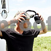 Rob Winner – rwinner@daily-chronicle.com<br /> <br /> Mitchell Hendrickson, of Hendrickson Flying Service located in Rochelle, puts on his ear muffs to protect his ears as a crop dusting helicopter prepares to land near Fenstermaker and Barber Greene roads in Cortland Township on Friday July 23, 2010.