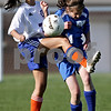 Beck Diefenbach  -  bdiefenbach@daily-chronicle.com<br /> <br /> Genoa-Kingston's Rachael Harris (7, left) and Hinckley-Big Rock's Nikki Banigan (14) clash for the ball during the second half of the game at G-K in Genoa, Ill., on Monday april 26, 2010. H-BR defeated G-K 5 to 1.