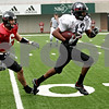 Rob Winner – rwinner@daily-chronicle.com<br /> <br /> Safety Jody Van Laanen (left) is unable to chase down wide receiver Anthony Johnson after a completed touchdown pass from DeMarcus Grady during Northern's final spring football practice in DeKalb, Ill. on Saturday April 24, 2010.
